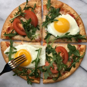 Gluten-free Cauliflower Cheese Pizza with eggs and tomatoes