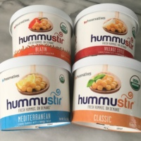 4 containers of hummus by Hummustir