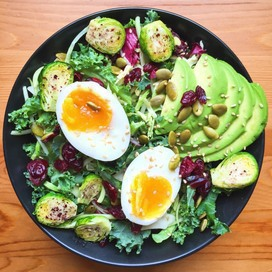 Salad with soft-boiled eggs and avocado