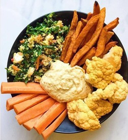 Hummus bowl with veggies and dippers