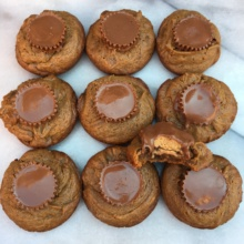 Gluten-free Peanut Butter Cup Cookies on a marble slab