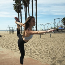 Jackie doing yoga at Santa Monica Beach