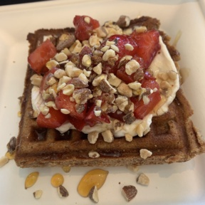 Paleo waffle with berries and cream from Beaming