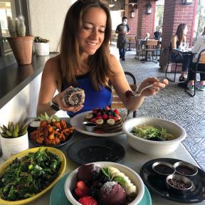 Jackie eating brunch at Cafe Gratitude in Venice
