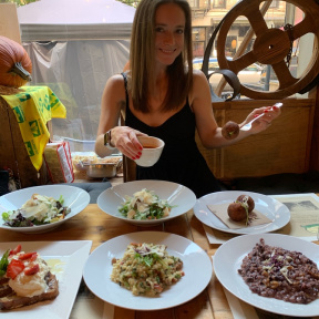 Jackie eating gluten-free arancini at Risotteria Melotti