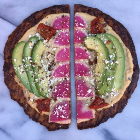 Sliced Cauliflower Pizza with Hummus, Watermelon Radish, Avocado, Feta