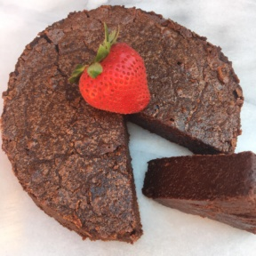 A slice of Flourless Chocolate Cake with strawberries