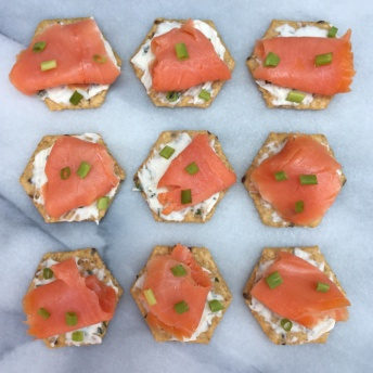 Gluten-free crackers topped with smoked salmon