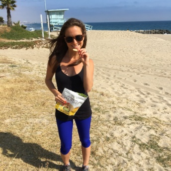 Jackie with Crunchmaster crackers on the beach