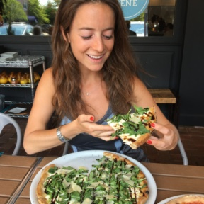 Jackie eating gluten-free pizza from Brick + Wood