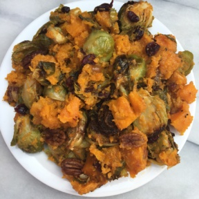 Roasted Brussels Sprouts and Squash with Almond Butter, Pecans, & Cranberries