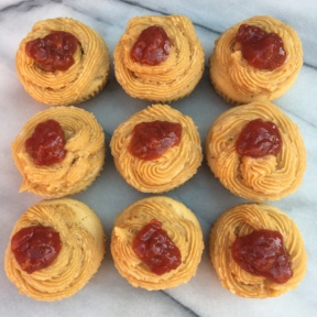 Almond Butter Cupcakes with Barney Butter frosting topped with jam