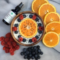 Gluten-free vegan yogurt bowl with Ora Organic omega-3 spray