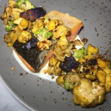 Gluten-free salmon entree from Society Cafe at Walker Hotel