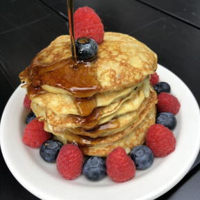 Gluten-free Two Ingredient Pancakes with berries and maple syrup