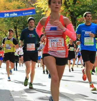 Jackie running the NYC Marathon in 2013