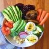 Bowl of veggies, eggs, and sesame seeds