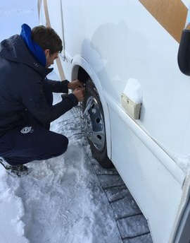 Brendan putting our snow chains on in Lake Tahoe