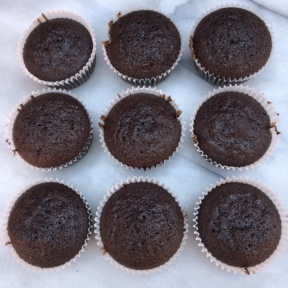 Gluten-free chocolate cupcakes ready to frost