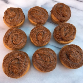 Nine gluten-free Double Maple Cupcakes