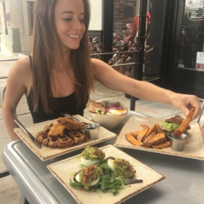 Jackie eating sweet potato fries at Primal Kitchen