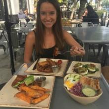 Jackie eating at Primal Kitchen Restaurant