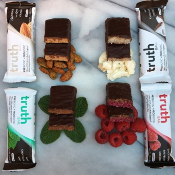 Gluten-free bars covered in dark chocolate by Truth Bar
