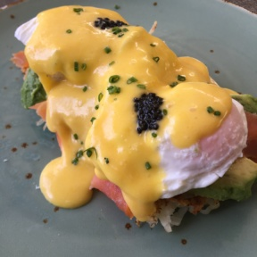 Gluten-free eggs Benedict on hash browns from Cheeky's