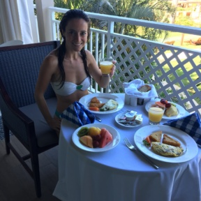 Jackie enjoying room service for breakfast at Sandals