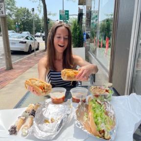 Jackie eating gluten-free subs from Lola's Italian Kitchen