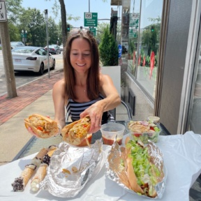 Jackie eating the chicken Philly sub from Lola's Italian Kitchen