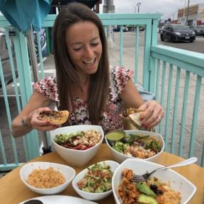 Jackie eating the GF burrito at Tocaya