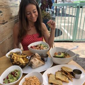 Jackie eating plantains and guac at Tocaya