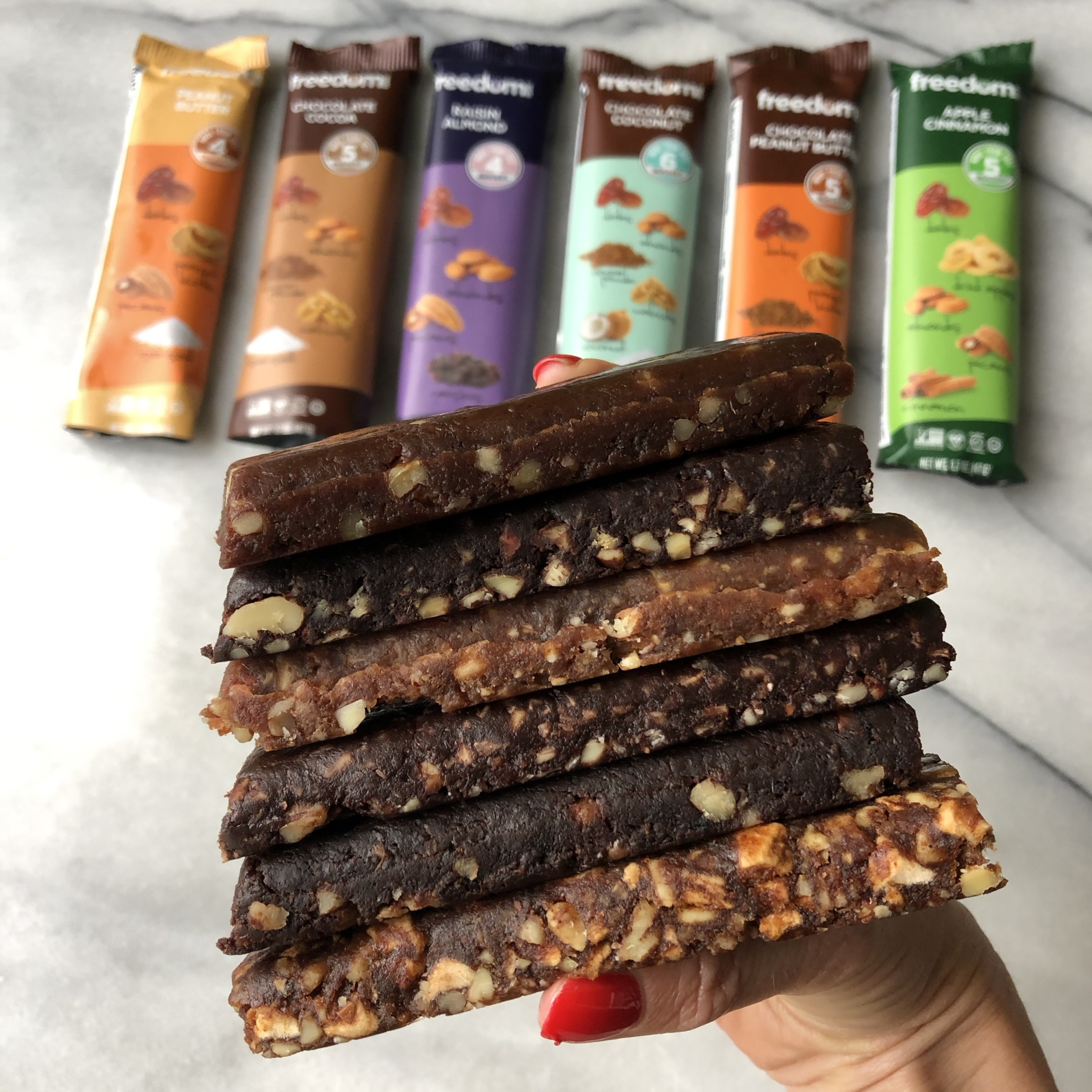 Stack of gluten-free bars by Freedom Bar