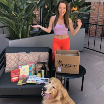 Jackie and Odie with Vitacost package