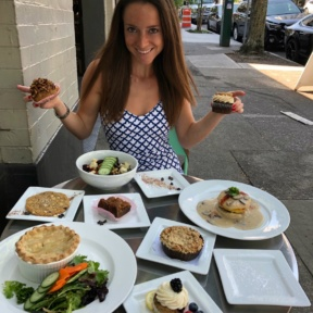 Jackie eating gluten-free desserts at Petunia's Pies & Pastries