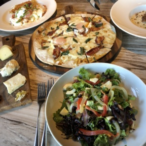Gluten-free pizza, cheese board, salad, and lobster scramble from N.10