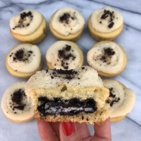 The inside of Cookie Stuffed Vanilla Cupcakes