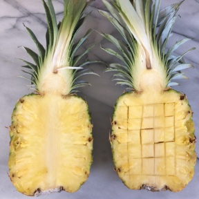 Cutting the pineapple for the pineapple boats