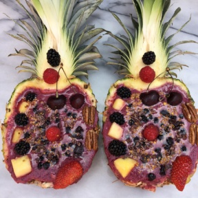Smoothie in Pineapple Boats with fresh and dried fruit