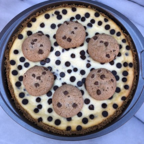 Chocolate Chip Cheesecake topped with cookies