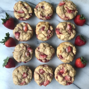 Strawberry Banana Protein Muffins with fresh strawberries
