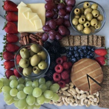 Gluten-free Cheese Platter with olives, fruit, and nuts