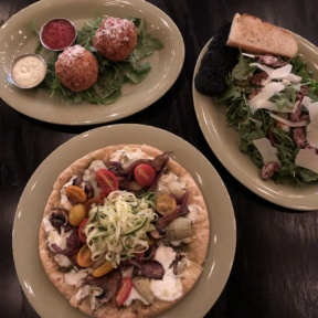 Gluten-free pizza, arancini, and salad from Mangia Nashville