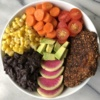 Black bean crusted cod with veggies in a bowl