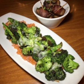 Gluten-free charred broccoli and bacon wrapped dates from Luna Red