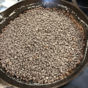 Adding chocolate for S'mores Skillet Dip
