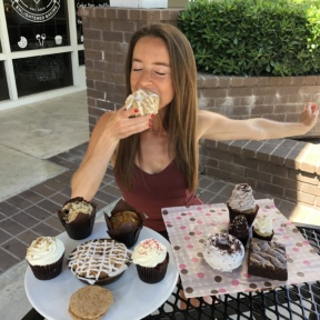 Jackie eating a donut at Karma Baker