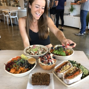 Jackie eating a 100% GF meal at Vibe Organic Kitchen