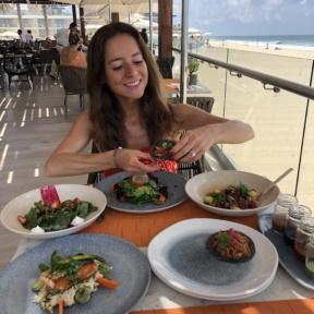 Jackie eating tacos at Blanc Ocean